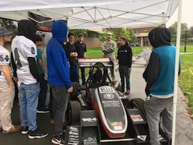 Students surround the RPI racecar