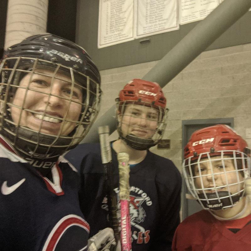 Jonna Gerken with her two sons in hockey gear