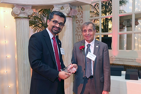 Professor Michael Shur receives the Outstanding Professor of Engineering Award from Dean Shekhar Garde